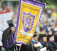 Katie Doyle carries the banner for the University of Mississippi's School of Law during graduation ceremonies in the Grove, in Oxford, Miss. on Saturday, May 11, 2013. (AP Photo/Oxford Eagle, Bruce Newman)