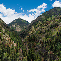 After leaving camp from Ouray, CO we started the drive up to Denver. The route we took was 50 north/west to Grand Junction and then 70 to Denver, the first 50 miles on rt 50 from our site were breathtaking ( not that all of Colorado isn't ). <br /> <br /> This was shot at one of the &quot;scenic overlooks&quot; along the windy mountain road...I loved the way the peak in the background is framed by the other two mountains on each side.