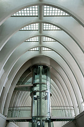 Glass elevator inside new Liège-Guillemins modern railway station designed by architect Santiago Calatrava  in Liege Belgium