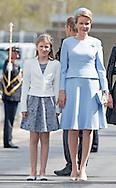 6-5-2015 ZEEBRUGGE BELGIUM - King Filip  and Queen Mathilde of Belgium and princess Elisabeth attends baptism ceremony of the P902 Pollux at the Navy Base in Zeebrugge, Belgium, 6 may  2015. COPYRIGHT ROBIN UTRECHT ZEEBRUGGE &ndash; De Belgische prinses Elisabeth heeft dinsdag op de marinebasis van Zeebrugge het patrouilleschip P902 Pollux gedoopt. De dertienjarige hertogin van Brabant, zoals de titel van de Belgische troonopvolgster luidt, werd vergezeld door haar ouders koning Filip en koningin Mathilde.<br /> <br /> Voor de jonge prinses Elisabeth was het de eerste keer dat ze een schip mocht dopen. Het kapotgooien van een fles champagne op de romp van de Pollux ging niet meteen goed, maar uiteindelijk slaagde Elisabeth toch in haar taak. Haar moeder doopte vorig jaar al het eerste patrouillevaartuig, de P901 Castor.<br /> <br /> Anders dan haar (bijna) leeftijdgenootje prinses Amalia in Nederland, wordt Elisabeth door haar ouders met enige regelmaat meegenomen bij publieke optredens en heeft de prinses ook al enkele offici&euml;le taken verricht. Zo las ze in oktober vorig jaar op Lichtfront, een herdenkingsplechtigheid in het kader van de Eerste Wereldoorlog, in de drie landstalen een brief voor waarin ze opriep de oorlog nooit te vergeten.