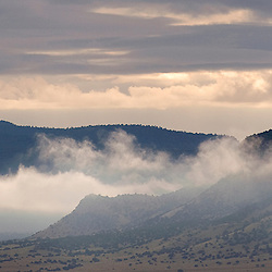 090810       Brian Leddy.Clouds shroud the base of Mount Taylor on Wednesday morning.