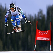 SHOT 12/1/11 12:49:05 PM - U.S. skiier Andrew Weibrecht launches himself off the Red Tail jump during men's downhill training on the Birds of Prey course at the Audi FIS World Cup on December 1, 2011 in Beaver Creek, Co. (Photo by Marc Piscotty / © 2011)