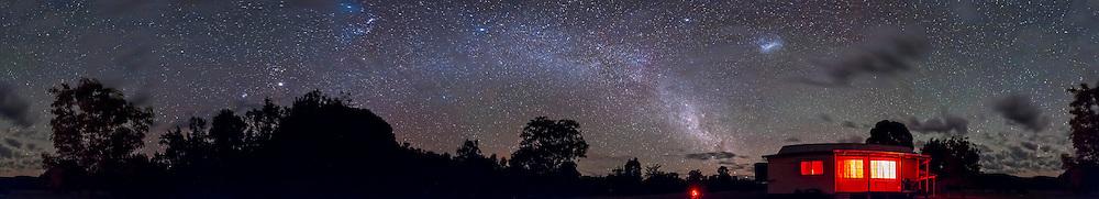 A 360° panorama of the southern sky, early evening, in late December 2012, from Timor Cottage, near Coonabarabran, NSW, Australia. Taurus, the Pleiades, Jupiter and Orion are left of centre over Timor Rock, the Milky Way extends from there to the right down toward the cottage, the Large Magellanic Clouds is right of centre over the cottage (the Small Cloud is behind cloud). .This is an 8-section panorama taken with the Canon 60Da and 10-22mm lens at 10mm, at f/3.5 for 1 minute each at ISO 3200. Stitched with Photoshop CS6.
