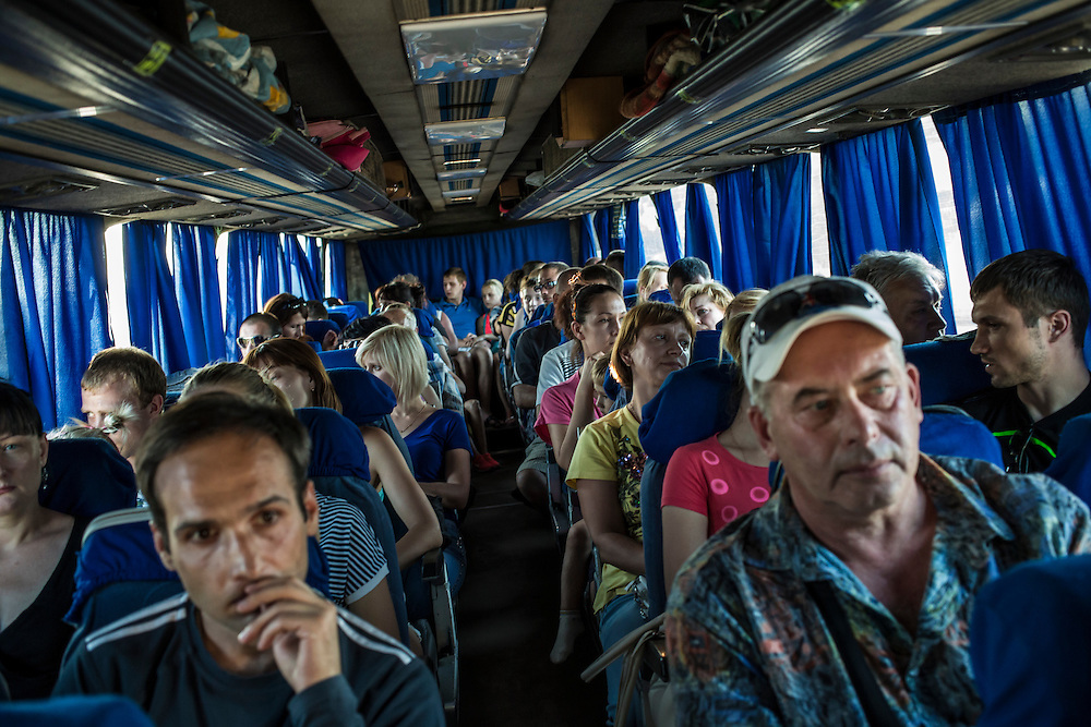 A bus transporting residents fleeing from fighting in nearby Horlivka carries them to Simferopol, in Crimea, on Sunday, July 27, 2014 in Makiivka, Ukraine.