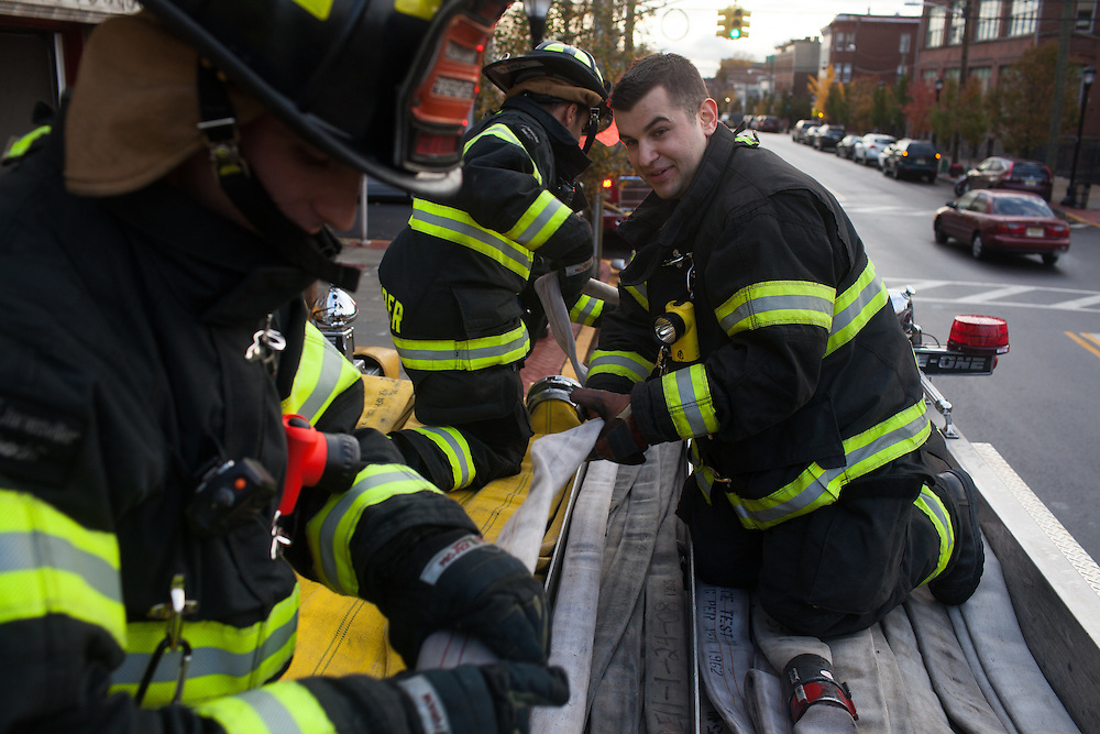 Fire fighters and military veterans AJ Maresca, left, and Kamil Mizinsky, right, work together at the 16th Street Fire House of the North Hudson Regional Fire and Rescue in Union City, NJ on November 07, 2013. Many vets say after the military they're still looking for a career with a sense of public service. Some vets have found that at the North Hudson Regional Fire and Rescue in New Jersey.