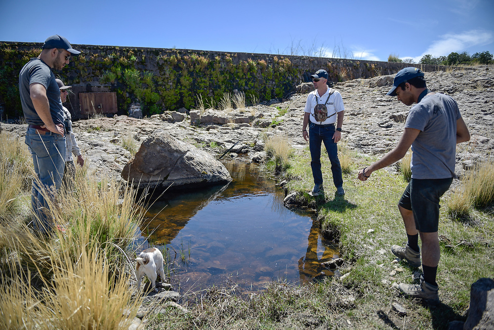 rer041417b/A1/April 14, 2017/Albuquerque Journal<br /> Story about how the proposed border wall by the Trump administration would have on the ecosystem throughout New Mexico's Coronado National Forest. Pictured from left to right standing at a spring runoff created by a dam in the background built in the 50's are Gabe Vasquez(Cq), southern New Mexico coordinator for the wildlife federation, Deming Public Schools assistant superintendent and avid sport man Ray Trejo(Cq), wildlife biologist Fernando Clemente(cq), and Zen Khan, a Burrell College of Osteopathic Medicine student. <br /> Roberto E. Rosales/Albuquerque Journal