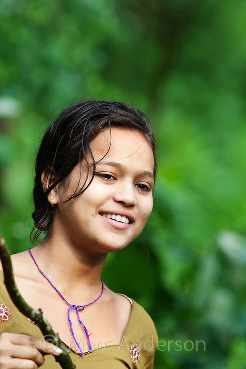 Portrait of a Tharu girl smiling, Terai region, Nepal