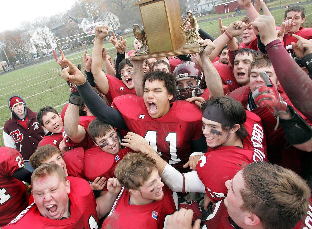 Gloucester: The Gloucester High School football team celebrate after beating Danvers 48-7 at Newell Stadium Thanksgiving Day. Gloucester finished their regular season with a perfect 11-0 record. They begin the playoffs against Masconomet on Tuesday at 4 p.m. in Lowell. .Photo by Mike Dean/Gloucester Daily Times Thursday, November 22, 2007