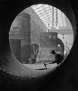 Boiler Shop Worker Seen Through Large Pipe, Vicker's Armstrong Steel Foundry, England, 1928