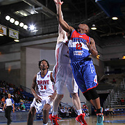 Delaware 87ers Guard Maalik Wayns (12) drives towards the basket as Grand Rapids Drive Guard Nate Wolters (21) defends in the first half of a NBA D-league regular season basketball game between the Delaware 87ers and the Grand Rapids Drive (Detroit Pistons) Saturday, Apr. 04, 2015 at The Bob Carpenter Sports Convocation Center in Newark, DEL.