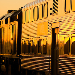 Late evening sun glints off the stainless steel sides of a westbound Metra commuter train at LaFox, IL.