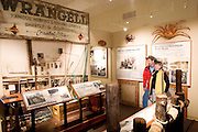 USA, Alaska, A man and woman enjoy the commercial fishing display at the Wrangell Museum, Wrangell. MR