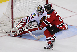 Mar 27; Newark, NJ, USA; Chicago Blackhawks goalie Corey Crawford (50) makes a save on New Jersey Devils right wing David Clarkson (23) during the overtime shootout at the Prudential Center. The Devils defeated the Blackhawks 2-1.