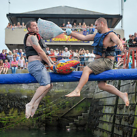 Pillow fight on the Greasy Pole during the Kinsale Regatta.