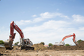 Excavators at Serra Way & Calaveras Blvd., Milpitas, California