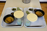 Two meals sit at the beginning of lunch break for the elderly prison inmates, in Onomichi prison, Japan. Monday, May 19th, 2008. Many of the elderly prisoners suffer from high blood pressure and diabetes, with 70-80% of them receiving medication.