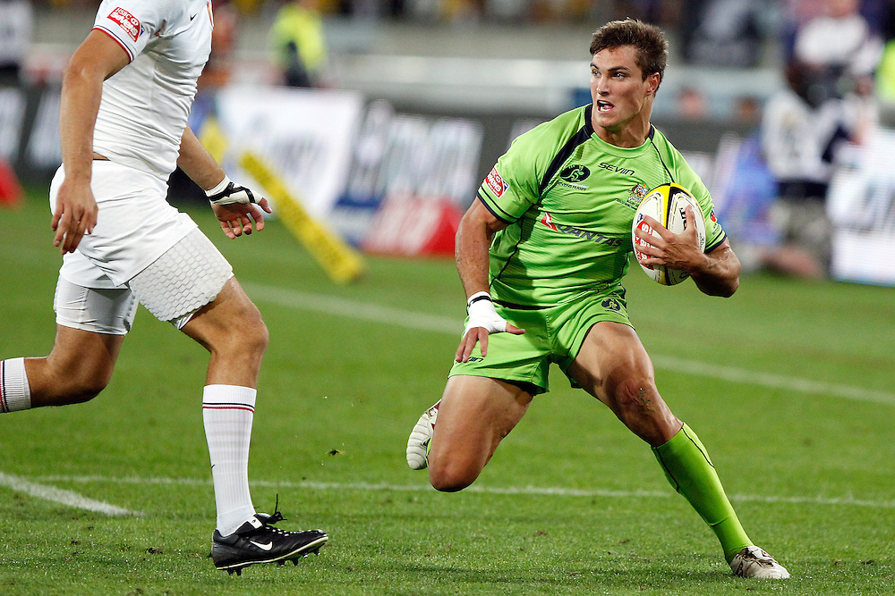 Ed Jenkins of Australia stops in a hurry to avoid a tackle during  day one of  the IRB Sevens Tournament, Wellington, New Zealand, Friday February 03, 2012. Credit: SNPA / Dean Pemberton