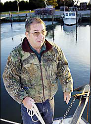Stevensville MD--1/14/04--Maryland Waterman's Association head Larry Simns casts off at dawn for a day working on the Chesapeake Bay. .PHOTO CREDIT: Marty Katz for the New York Times