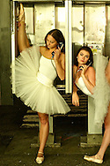 Portrait of three ballerinas in white tutu around Manhattan at night.