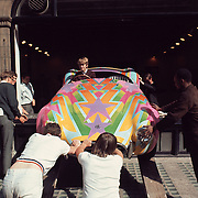"""Honorable Tara Browne, friend of the Beatles in his psychedelic-painted AC Cobra exiting window of Robert Fraser Gallery.  Published in Jon Naar's """"Getting the Picture"""", 2005. Taken with a 6x6 cm Hasselblad in 1966."""