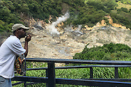 "Soufriere, Saint Lucia: Sulfur steam rises from the vents in the crust of ""the Caribbean's only drive-in volcano,"" the collapsed caldera that forms part of the western portion of the island of Saint Lucia."