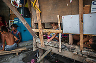 The legacy of colonialism in the Parolas slum in Tondo.  Despite being a country of beautiful people, the centuries of colonialism, first the Spanish and then the Americans, there is a tendency to look outside themselves to a western standard of beauty.  Even within the country, those with perhaps mixed ancestry or have lighter skin and fine features are favored and considered more desirable.  Parolas slum, Tondo, Manila, Philippines.