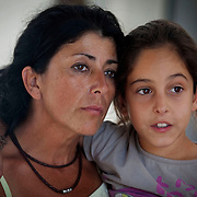 Lola Alvarez, spokesperson for Somonte and her great neice Beatriz..As a result of Spain's prolonged and worsening economic crisis a cooperative called Somonte has formed. Approximately a year ago they occupied land and farm buildings near the village of Palma del Rio in Cordoba Province. They have begun to manually cultivate some of the land and are now able to grow enough food to support their community of 20 plus members.  Excess food, particularly red peppers which are a speciality of the COOP are taken and sold at market along with other produce from the farm.  In addition to the humans who have reclaimed the land and are living together in the commune there is a small selection of livestock such as chickens, sheep, goats and a lone donkey called Manolo.  The individuals who make up the cooperative come from various parts of Spain and diverse backgrounds. They are often joined by international visitors who spend anything from a few days to a few weeks working alongside them in support of their ideas and backing them in their fight against the severe economic problems that have left vast numbers of Spaniards unemployed and many attempting to survive below the poverty line and with insufficient food to eat as a result. Palma del Rio, Cordoba, Andalucia, Spain on the 19th of September 2012.