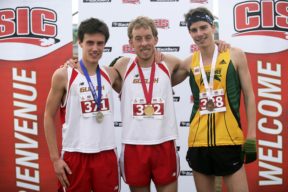 (Kingston, Ontario -- 14 Nov 2009) The medalists in the men's race at the 2009 Canadian Interuniversity Sport CIS Cross Country Championships. Gold: Matt Brunsting (center) from the University of Guelph; Silver: Kyle Boorsma (Left) from the University of Guelph; Bronze: Kelly Wiebe (right) from the University of Regina. The race was held at Forth Henry Hill in Kingston Ontario. Photograph Copyright Sean Burges / Mundo Sport Images, 2009.