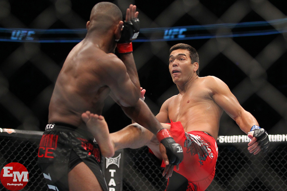 Toronto, Ontario, Canada - December 10, 2011: UFC Light Heavyweight Champion Jon Jones (black trunks) and challenger Lyoto Machida (red trunks) during UFC 140 at the Air Canada Centre in Toronto, Canada.