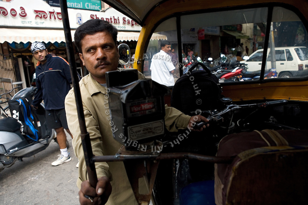 Shafiq Syed, 34, is parking his rickshaw in the city centre of Bangalore, Karnataka, India. Shaifq has been the main character of the Cannes' Camera D'Or 1988 winner Salaam Bombay, but after the movie he failed to become a star, fell back into poverty and lived on the streets for years before he became a rickshaw (tuk-tuk) driver in his home city of Bangalore, Karnataka State, India.
