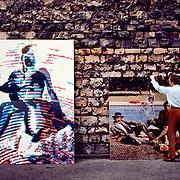 Alain Jacquet showing his work on wall in Montmatre near jis studio.  Taken with a 35 mm Nikon FM in 1980.