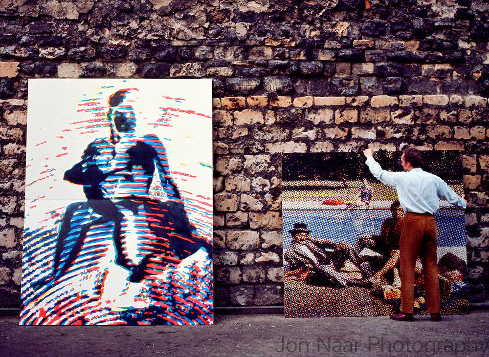 Alain Jacquet showing his work on wall in Montmatre near jis studio.  Taken with a 35 mm Nikon FM in 1980.