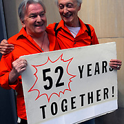 "Gay couple with sign ""52 Years Together"" at the Gay Pride Parade in New York City"
