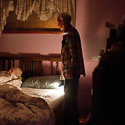 Bernard checks on Mary after she called out for him late at night. Bernard likes to stay up at night and Mary gets frightened when she goes to bed alone. The care he must provide her with is never ending.