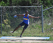 Oxford High's Larry Pettis throws the discus at a high school track meet in Oxford, Miss. on Saturday, April 23, 2011.