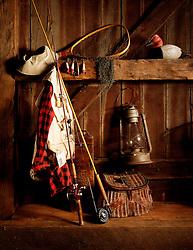 still life sportsman items fly rod fishing vest creel net duck decoy gas lantern