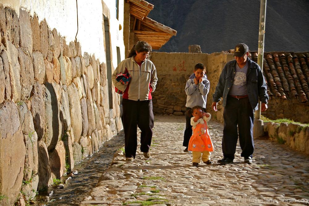Americas, South America, Peru, Ollanta. Local family walks the Incan street of Ollanta.