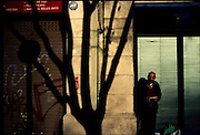 ©Stefano Meluni.20-12-2004 Barcelona Spain.City overview of Barcelona.nella foto: man in standing down the sun