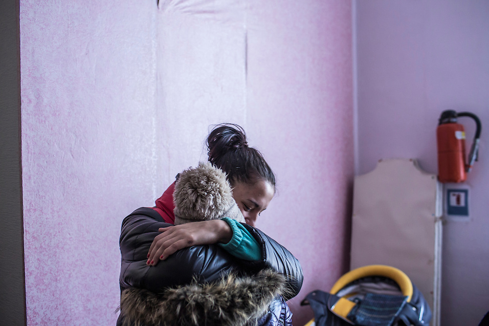 MYRONIVSKYI, UKRAINE - FEBRUARY 17: Two girls share a hug at a distribution point for humanitarian aid at the local House of Culture on February 17, 2015 in Myronivskyi, Ukraine. A ceasefire agreed to by Ukraine and pro-Russian rebel forces has failed to prevent fighting in the nearby town of Debaltseve, where thousands of Ukrainian troops remain and whom rebels claim to have surrounded. (Photo by Brendan Hoffman/Getty Images) *** Local Caption ***