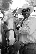 "Photographs of African American cowboys/cowgirls at work and play during their annual ""High Noon Ride"" for charity staged in Washington Park located in the heart of Chicago's South Side neighborhood."