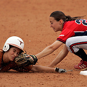 Freshman Crystal Saenz is tagged out by Jessica Valis while attempting to steal second base during the 6th inning.