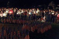 Washingtonville, N.Y. - People hold candles at the Washingtonville 5 Firefighters World Trade Center Memorial during a memorial service on Sept. 11, 2006. The Memorial was built in honor of five FDNY firefighters from Washingtonville and the many others who lost their lives on September 11, 2001 in the World Trade Center terrorist attack.