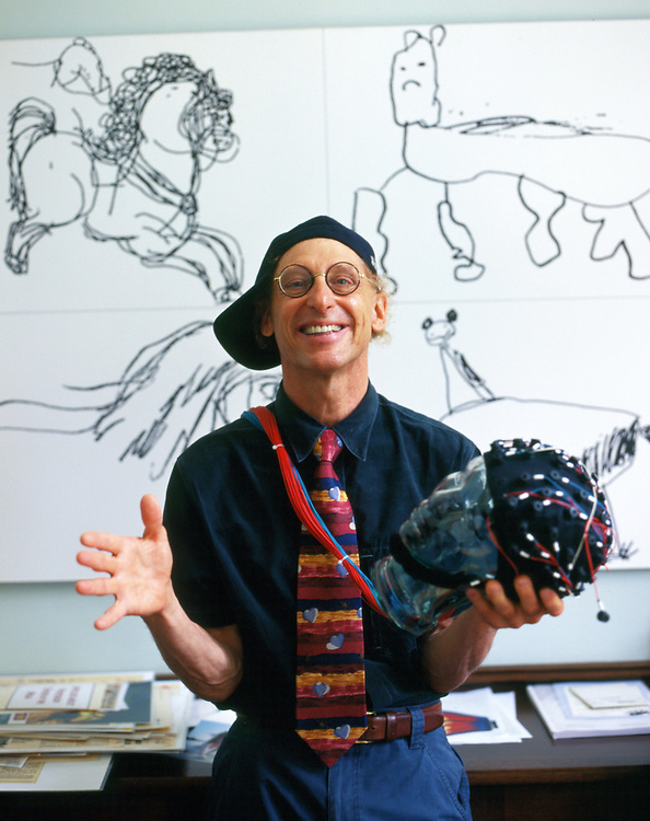 """Professor Alan Snyder of The Centre for the Mind at Sydney University with his """"think cap"""". The pictures on the wall were drawn by four year old autistic children..Sydney, March 2003"""