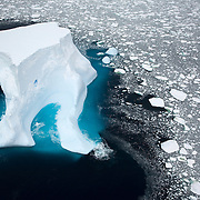 February 14th 2007. Southern Ocean. An iceberg floats in sea ice of the Ross Sea.