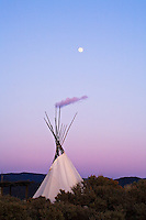 Moonrise over a TeePee near Taos, New Mexico.