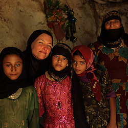 Photojournalist Stephanie Sinclair with eight-year-old brides Tehani and Ghada inside their mountain home in Hajjah, Yemen, Jan. 29, 2010.