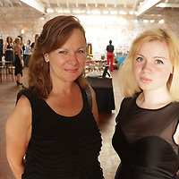 Charlotte Lickfeld, left, and Rachel Lickfeld pose for a photo during Fashion On Front Thursday August 21, 2014 at Bakery 105 in Wilmington, N.C.(Jason A. Frizzelle)