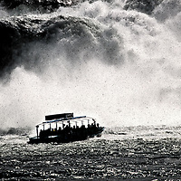 dramatic view of boat at waterfall
