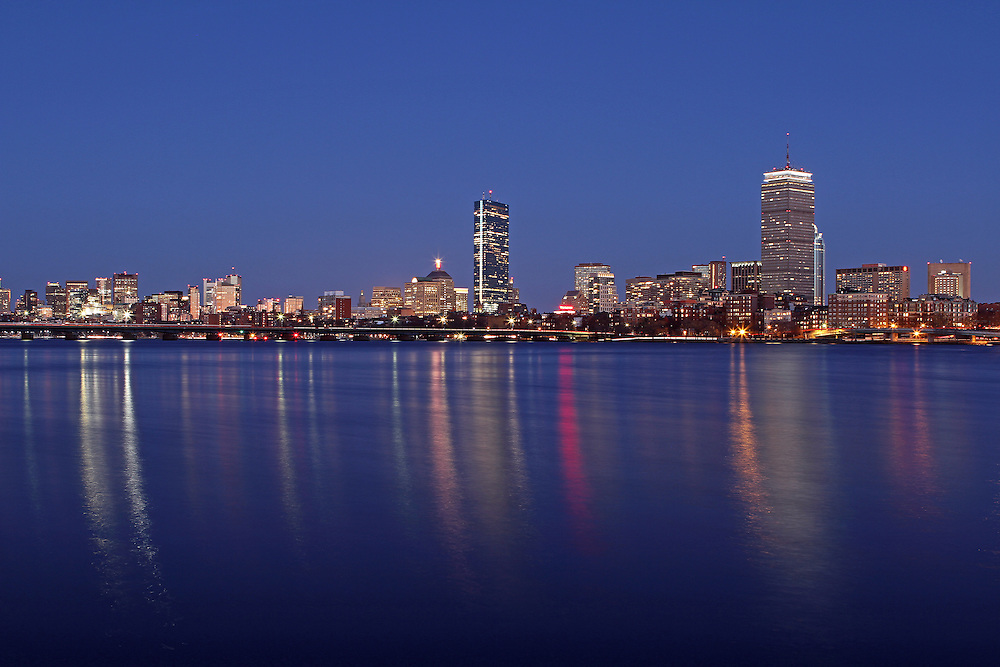 Blue Night Boston skyline photography pictures are available as museum quality photography prints, canvas prints, acrylic prints or metal prints. Prints may be framed and matted to the individual liking and decorating needs:<br /> <br /> http://juergen-roth.artistwebsites.com/featured/blue-night-juergen-roth.html<br /> <br /> Blue Night, magical Boston skyline photography image featuring famous architecture landmarks such as the Boston Prudential Center, John Hancock Building and Back Bay brownstones reflected in the Charles River. The cityscape photograph was taken in spring minutes after the sun disappeared below the horizon at twilight.<br /> <br /> Boston provides the local and travel photographer with unique, beautiful, historic and modern architecture. The city is a wonderful mix of old and new buildings that make for fantastic photo subjects. Early morning and late afternoon often provide the best light for stunning skyline photography; however it is no secret that twilight makes for greatest photography. <br /> <br /> Good light and happy photo making! <br /> <br /> My best, <br /> <br /> Juergen<br /> Art Prints: www.RothGalleries.com<br /> Image Licensing: www.ExploringTheLight.com<br /> Twitter: @NatureFineArt<br /> Facebook: https://www.facebook.com/naturefineart