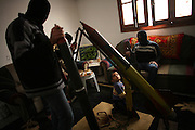 Militants of Fatah's Al Aqsa Brigades with rockets in the home of Khali El Kordey,32, with his four year old son Abed. The militants claim that the rockets Aqsa 101 ,the smallest, has a range of 7-8 kilometers with a head of 2 kilos of TNT, and the updated Aqsa rocket 103 has a range of 12-15 kilometers with a head of 4 kilos of TNT.